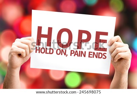 Hope - Hold On, Pain Ends card with colorful background with defocused lights - stock photo