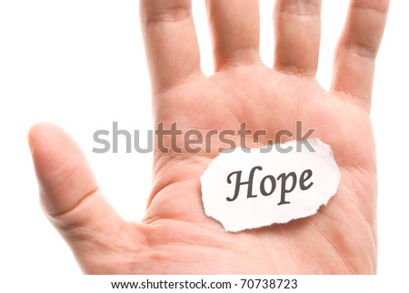 Hope word in hand, word on piece tear paper