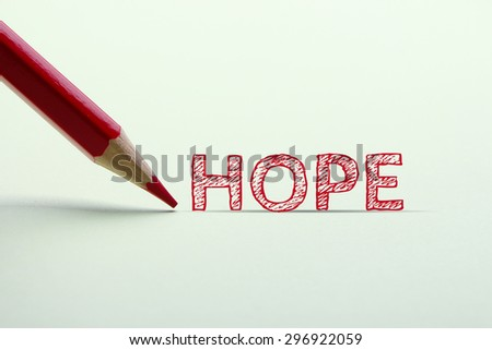 Hope word is standing on the paper with red pencil aside. - stock photo