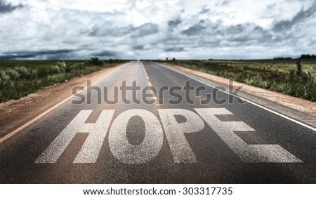 Hope written on rural road - stock photo