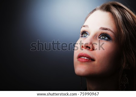 Hopeful young cute woman glancing into her future - stock photo