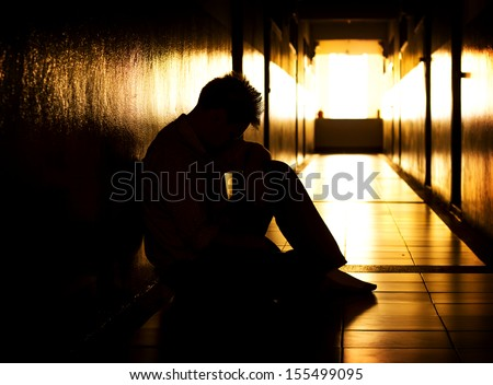 Hopeless man in dramatic scene. - stock photo