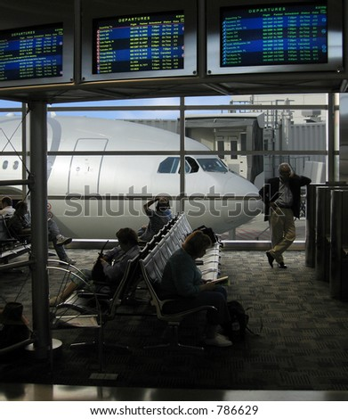 Hoping for an on-time departure, travelers wait - stock photo