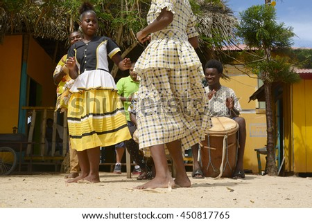 Hopkins Village, Belize - July 03, 2016: Garifuna troupe performs traditional songs with drumming and dancing in Hopkins Village. - stock photo