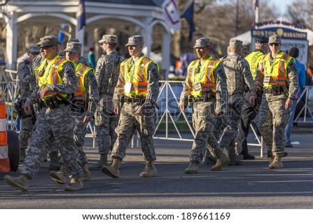 HOPKINTON, USA - APRIL 21: American Army deployed to enforce security at the starting line of the Boston Marathon 2014 in Hopkinton, Massachusetts, USA on April 21, 2014. - stock photo