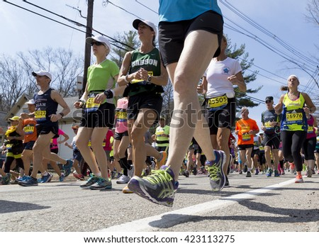 HOPKINTON, USA - APRIL 18: Athletes competing at the Boston Marathon 2016 a few minutes after the start of the race in Hopkinton, MA, USA on April 18, 2016.