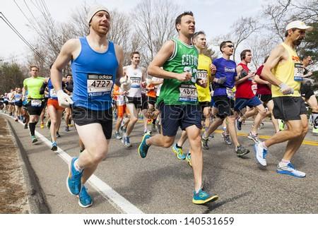 HOPKINTON, USA - APRIL 15, 2013: Athletes of the Boston Marathon heading fast and steadily from the starting line in Hopkinton to the finishing line in Boston, Massachusetts, USA on April 15, 2013. - stock photo