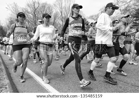 HOPKINTON, USA - APRIL 15: Athletes of the Boston Marathon 2013 heading from the starting line in Hopkinton to the finishing line in Boston, Massachusetts, USA fast and steadily on April 15, 2013.