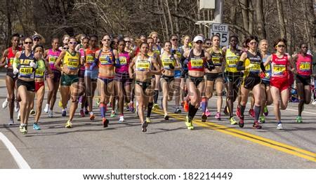 HOPKINTON, USA - APRIL 15, 2013: Elite female athletes running fast and steadily from Hopkinton to Boston in Massachusetts, USA during the Boston Marathon 2013 on April 15, 2013. - stock photo
