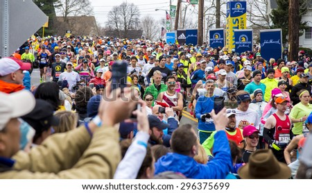 HOPKINTON, USA - APRIL 20: Regular athletes competing in the Boston Marathon 2015 in Hopkinton, MA, USA a few minutes after the start of the race on April 20, 2015.