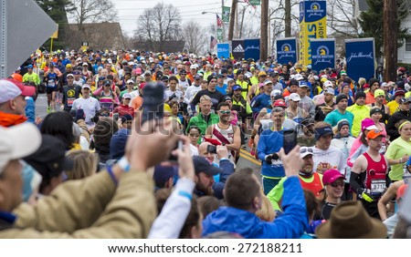 HOPKINTON, USA - APRIL 20, 2015: regular athletes heading fast and steadily from Hopkinton to Boston a few minutes after the start of the Boston Marathon 2015 in Hopkinton, MA, USA on April 20, 2015.