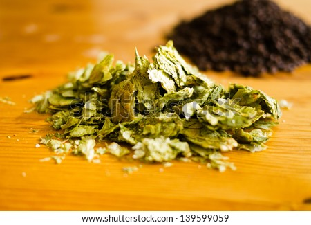 Hops and Malt for brewing - stock photo