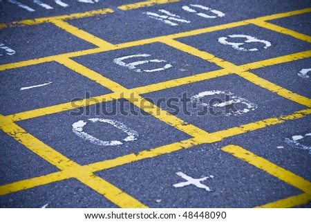 Hopscotch board on school playground - stock photo