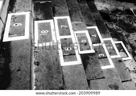 hopscotch childhood game on black and white - stock photo