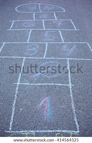 Hopscotch drawn on asphalt. Soft focus on number 1 - stock photo