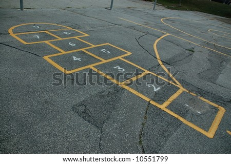 Hopscotch game in schoolyard - stock photo
