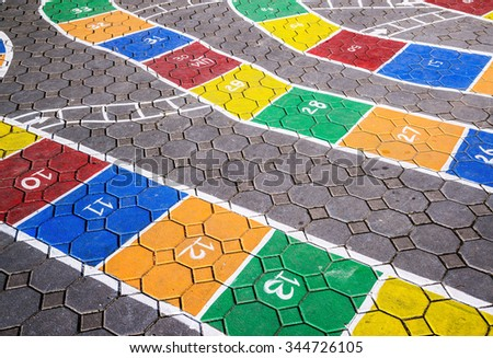 Hopscotch game on pavement in school - stock photo
