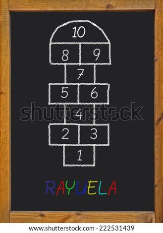 hopscotch on a blackboard - stock photo