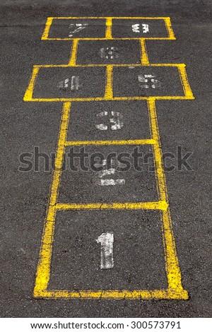 Hopscotch popular street game in schoolyard pavement. - stock photo