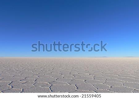 Horizon of salt desert toked at Salar de Uyuni Bolivia - stock photo