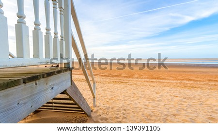 horizon view from a beach hut at low tide - stock photo
