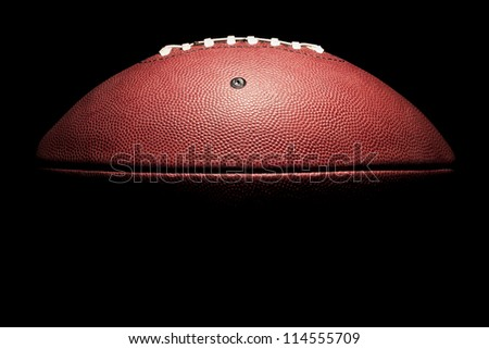 Horizontal American Style Football in high contrast on black - stock photo