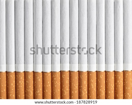 Horizontal background from a number of cigarettes - stock photo