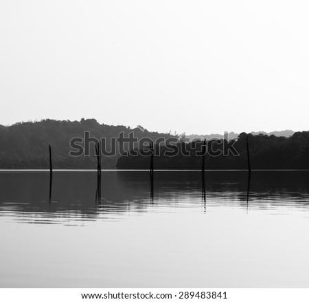 Horizontal black and white fishing nets reflections background backdrop - stock photo