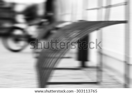 Horizontal black and white motion blur bicycle holders abstraction background