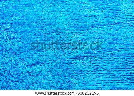 Horizontal blue beach towel textured background - stock photo