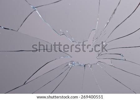 horizontal broken glass grey background - stock photo