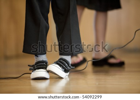 Horizontal close-up image of a boy on stage showing a little stage-fright. - stock photo