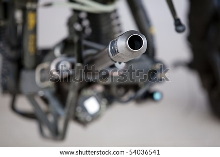 Horizontal close up image of an M230 Chain Gun 30mm auto cannon on an AH-64 Apache helecopter. - stock photo