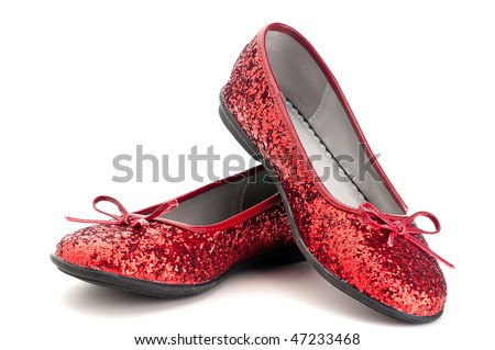 Horizontal close up of sparkling red slippers - stock photo