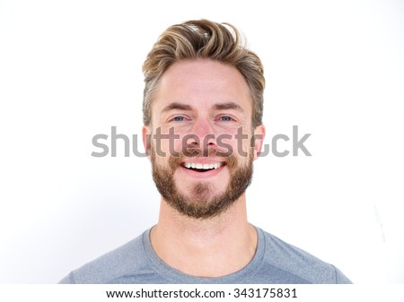 Horizontal close up portrait of a man with beard laughing on isolated whit background - stock photo