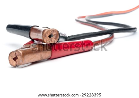 Horizontal closeup of old car booster jump start cables on a white background - stock photo