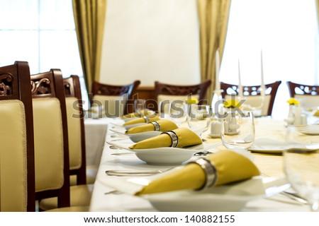 horizontal color image of restaurant table arrangement - stock photo