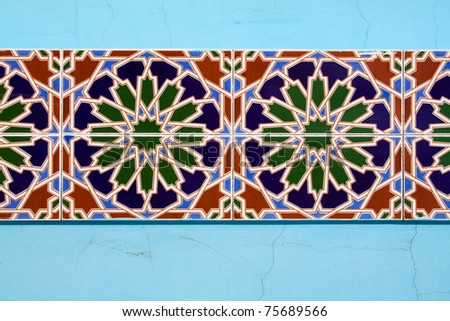 Horizontal colorful mosaic tile texture on the wall - stock photo