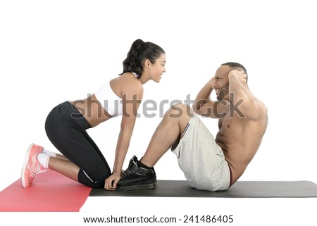 Horizontal composition of a fitness couple exercising together on floor - stock photo