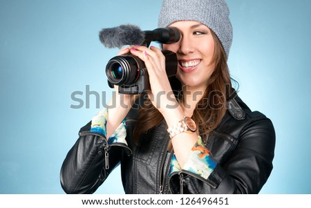 Horizontal Composition of Hip Young Adult Female Pointing Video Camera Recording  - stock photo