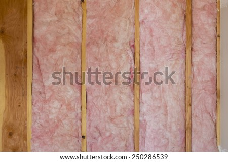 Horizontal Detail Shot of Fiberglass Installation in New Home Construction - stock photo