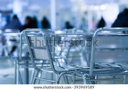 Horizontal empty cafe table with chairs bokeh background