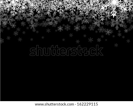 Horizontal frame with snowflakes falling down into darkness - stock photo