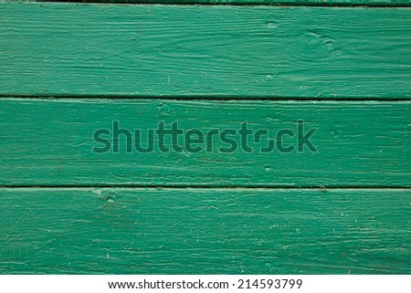 horizontal green wooden planks with peeling old paint, texture - stock photo