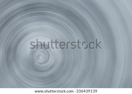 Horizontal grey and white swirling blur background