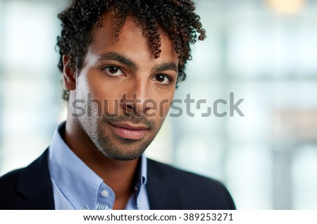 Horizontal headshot of an attractive african american businessman shot with shallow depth field. - stock photo