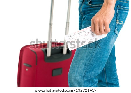 Horizontal image of a human hand holding air ticket isolated - stock photo