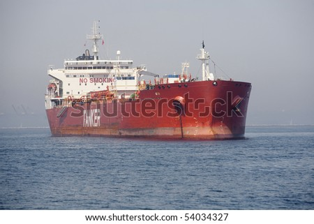 "Horizontal image of a red Ultra Large Crude Carrier, or ""Super Tanker.""  These vessels are capable of carrying up to two million barrels of oil across the seas. - stock photo"