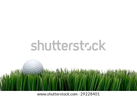 Horizontal image of a white golf ball in green grass on a white background with space for copy