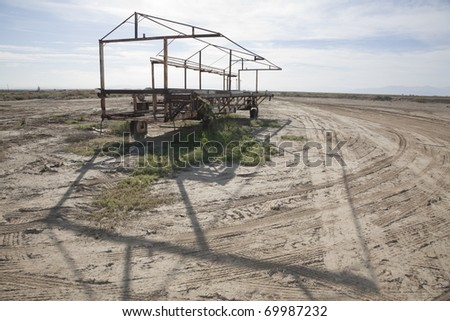 Horizontal image of an abandoned rusty piece of agricultural equipment. - stock photo